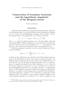 Construction of boundary invariants and the logarithmic singularity of the Bergman kernel